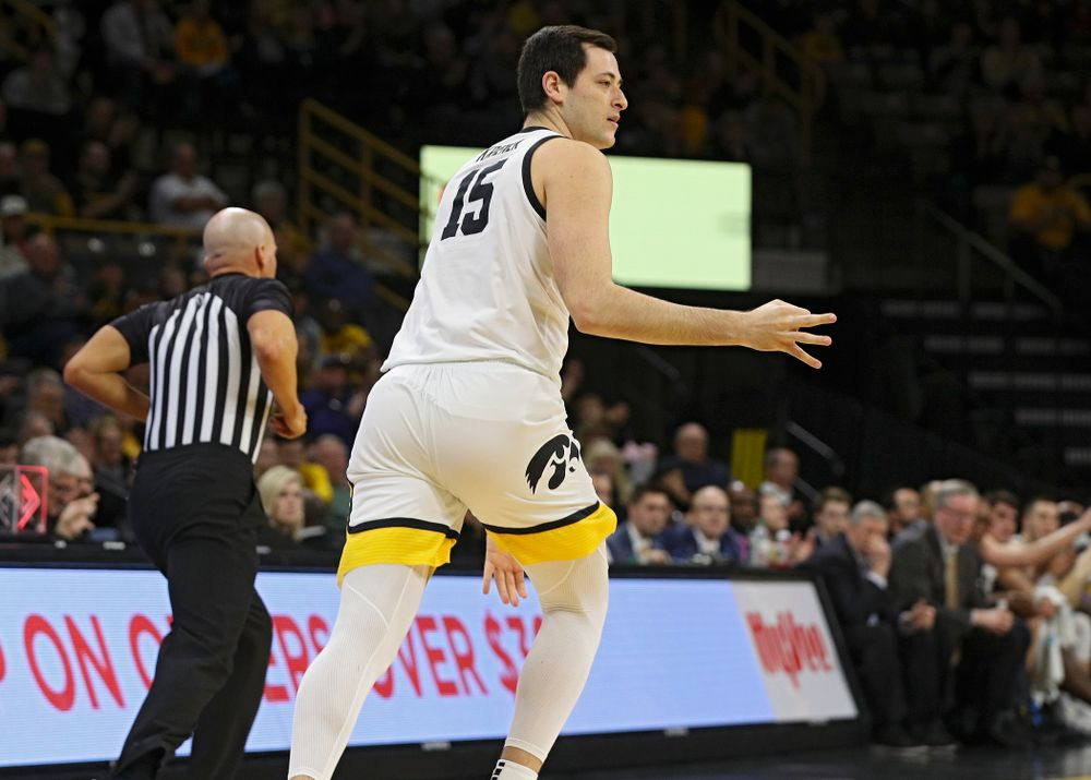 Iowa Hawkeyes forward Ryan Kriener (15) holds up three fingers after making a 3-pointer during the first half of their their game at Carver-Hawkeye Arena in Iowa City on Sunday, December 29, 2019. (Stephen Mally/hawkeyesports.com)