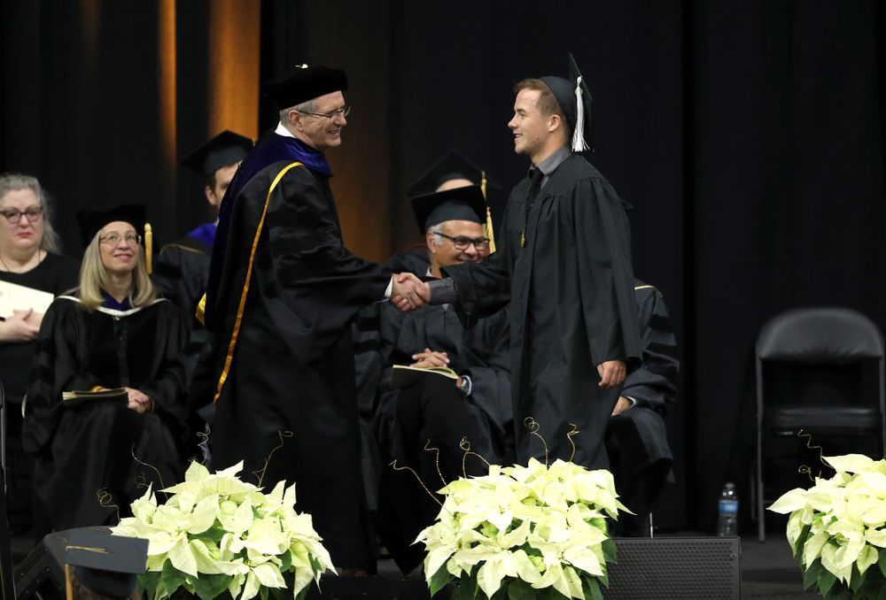 Iowa Football Manager Hayden Meister during the Fall Commencement Ceremony  Saturday, December 15, 2018 at Carver-Hawkeye Arena. (Brian Ray/hawkeyesports.com)