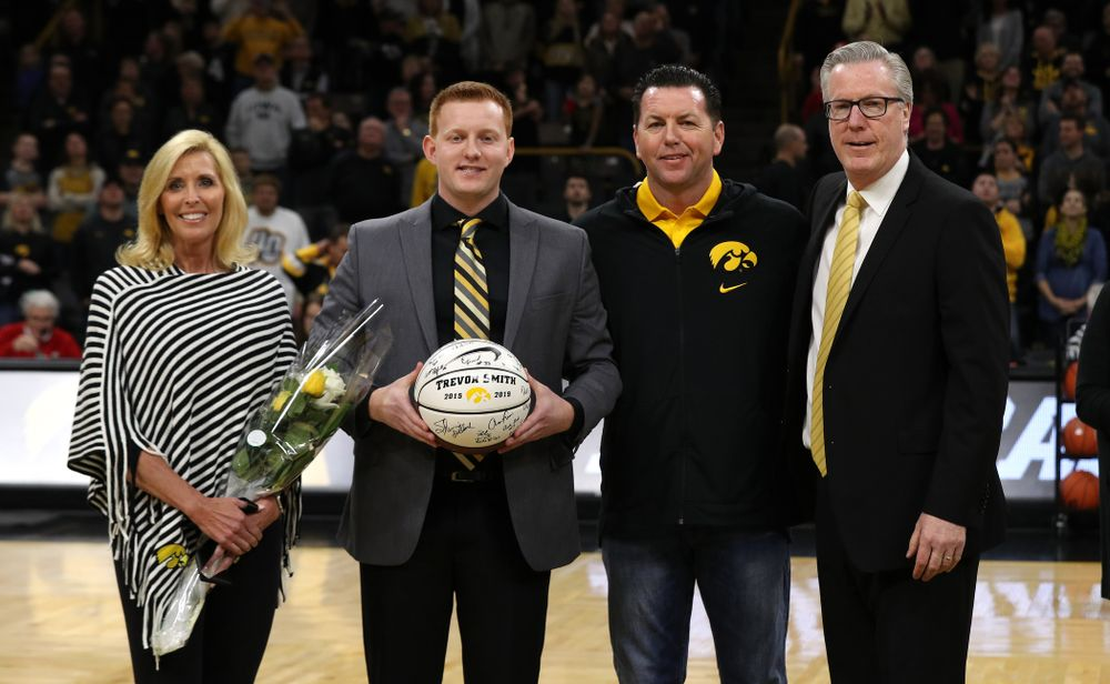 Senior Manager Trevor Smith stands with Iowa Hawkeyes head coach Fran McCaffery and his family during senior day activities before their game against the Rutgers Scarlet Knights  Saturday, March 2, 2019 at Carver-Hawkeye Arena. (Brian Ray/hawkeyesports.com)