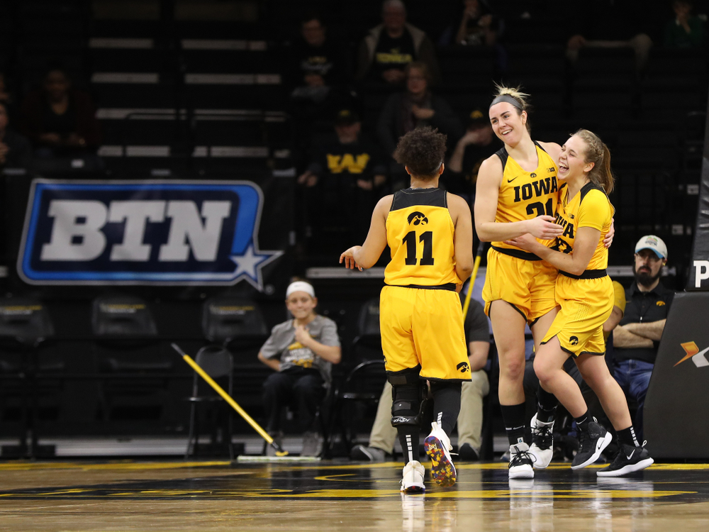 Iowa Hawkeyes forward Hannah Stewart (21) and guard Kathleen Doyle (22) against the Michigan State Spartans Thursday, February 7, 2019 at Carver-Hawkeye Arena. (Brian Ray/hawkeyesports.com)