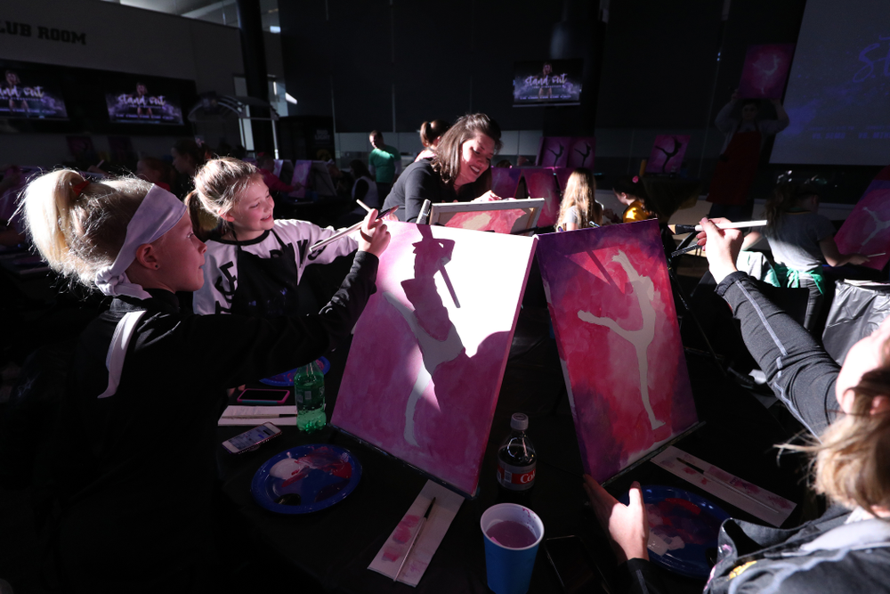 Fans of the GymHawks paint a gymnast with Brush and Barrel before the Iowa Hawkeyes  meet against the Minnesota Golden Gophers Saturday, January 19, 2019 at Carver-Hawkeye Arena. (Brian Ray/hawkeyesports.com)