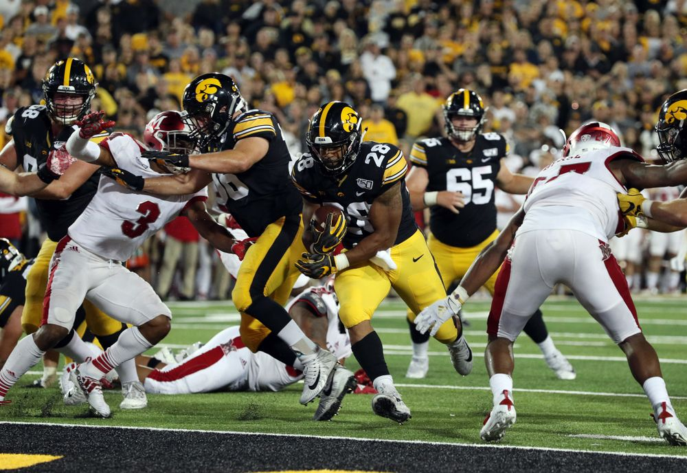 Iowa Hawkeyes running back Toren Young (28) scores a touchdown against the Miami RedHawks Saturday, August 31, 2019 at Kinnick Stadium in Iowa City. (Brian Ray/hawkeyesports.com)