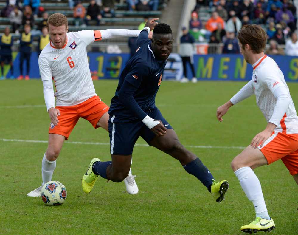 Virginia's Daryl Dike (9) and Clemson's Tanner Dieterich (6) battle for the ball during the 2019 ACC Men?s Soccer Championship at WakeMed Soccer Park in Cary, N.C., Sunday Nov. 17, 2019. (Photo by Sara D. Davis, the ACC)