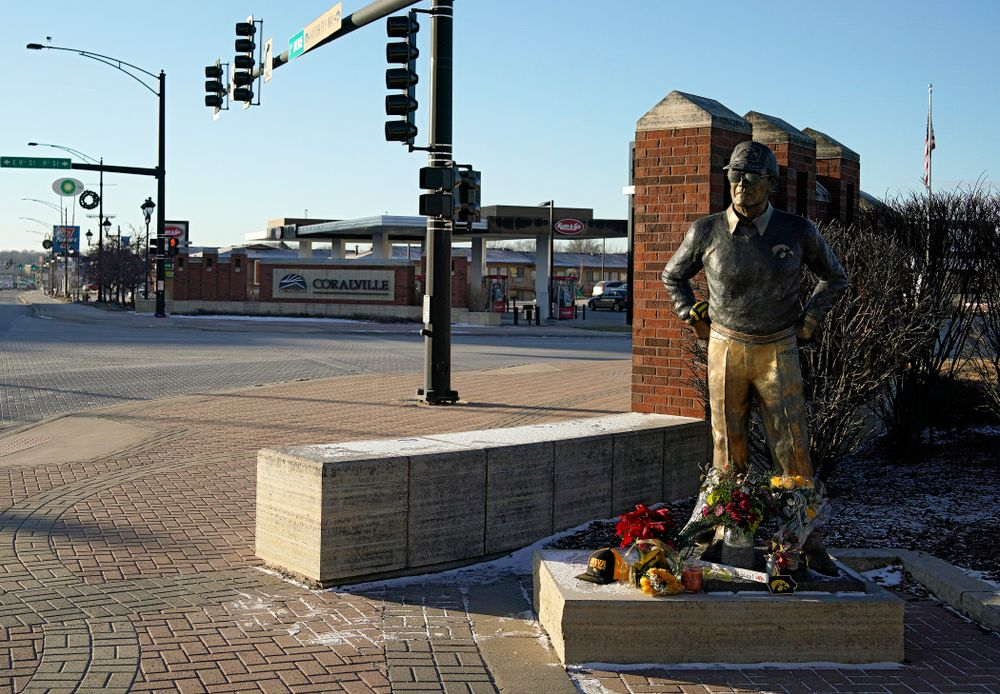 A memorial at the base of the Hayden Fry statue in Coralville on Wednesday, December 18, 2019. Hayden Fry passed away on Dec. 17, at the age of 90. (Stephen Mally/hawkeyesports.com)