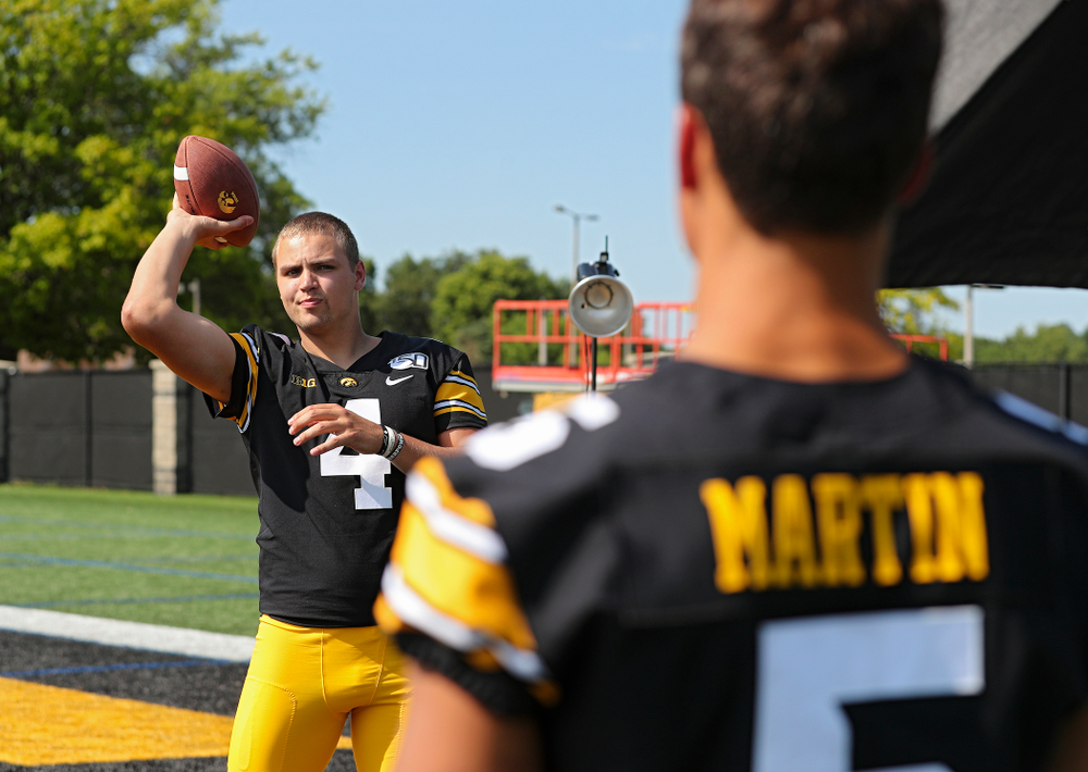 Iowa Hawkeyes quarterback Nate Stanley (4) throws a ball to wide receiver Oliver Martin (5) during Iowa Football Media Day at the Hansen Football Performance Center in Iowa City on Friday, Aug 9, 2019. (Stephen Mally/hawkeyesports.com)