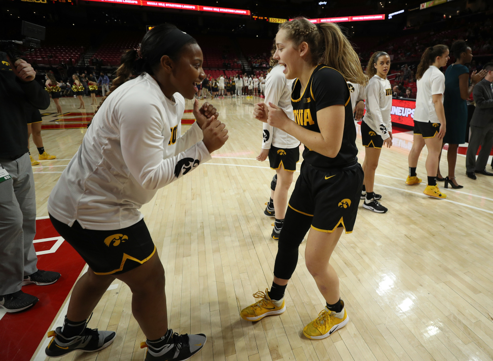 Iowa Hawkeyes guard Kathleen Doyle (22) and guard Zion Sanders (21) against the Maryland Terrapins Thursday, February 13, 2020 at the Xfinity Center in College Park, MD. (Brian Ray/hawkeyesports.com)