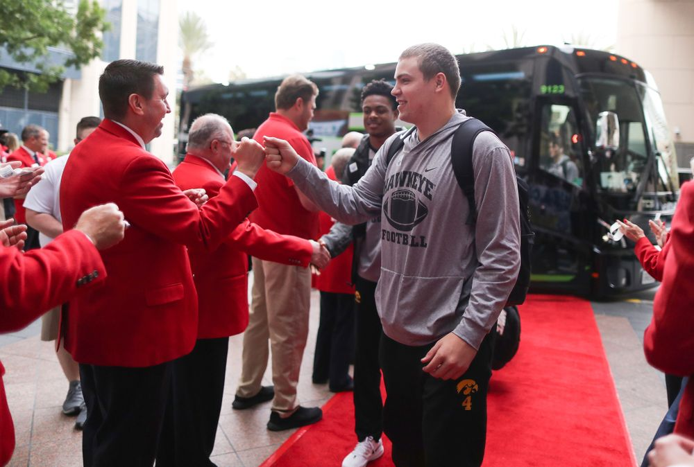 Iowa Hawkeyes quarterback Nate Stanley (4) shakes hands with the ÒRed CoatsÓ after arriving in San Diego, CA Saturday, December 21, 2019 for the Holiday Bowl. (Brian Ray/hawkeyesports.com)