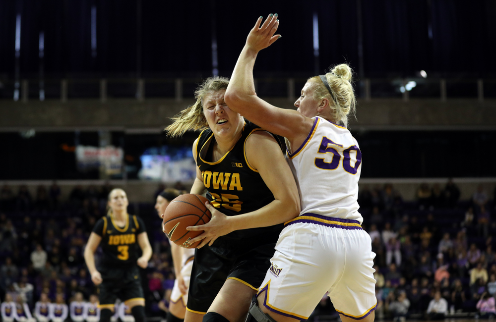 Iowa Hawkeyes forward/center Monika Czinano (25) drives to the hoop against Northern IowaÕs Megan Maahs (50) Sunday, November 17, 2019 at the McLeod Center. (Brian Ray/hawkeyesports.com)