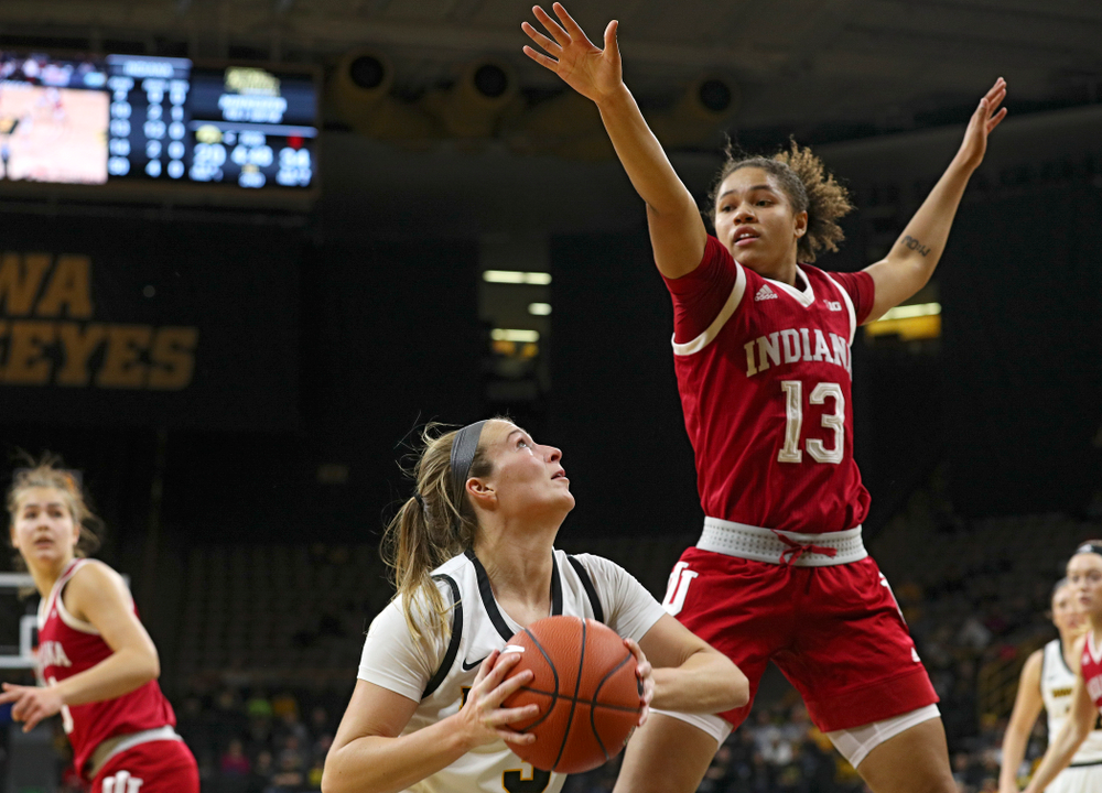 Iowa Hawkeyes guard Makenzie Meyer (3) waits for Indiana Hoosiers guard Jaelynn Penn (13) to clear before making a basket during the second quarter of their game at Carver-Hawkeye Arena in Iowa City on Sunday, January 12, 2020. (Stephen Mally/hawkeyesports.com)