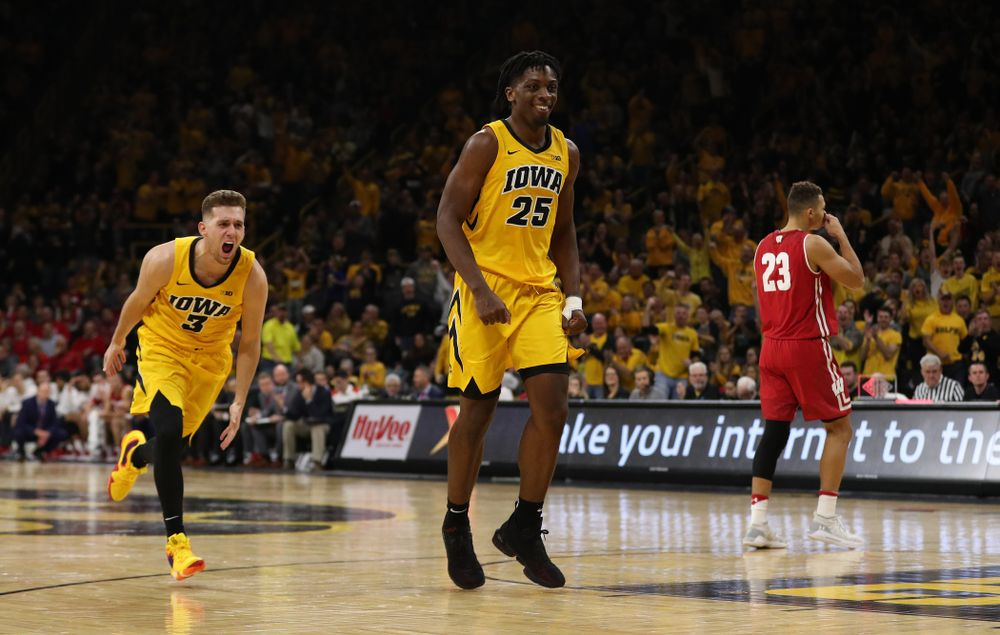 Iowa Hawkeyes guard Jordan Bohannon (3) and forward Tyler Cook (25) against the Wisconsin Badgers Friday, November 30, 2018 at Carver-Hawkeye Arena. (Brian Ray/hawkeyesports.com)