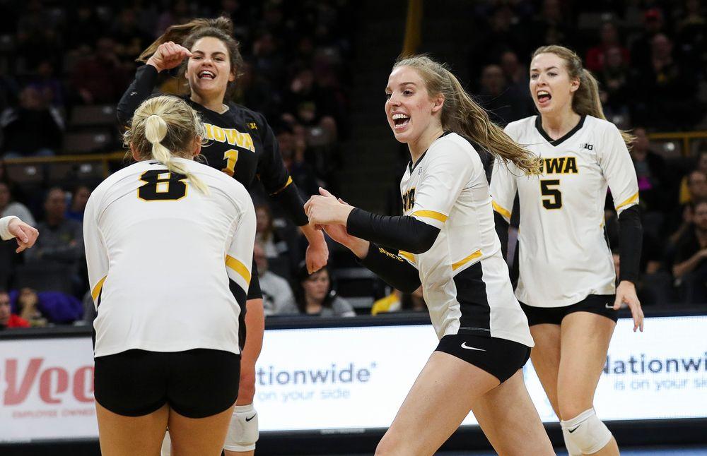 Iowa Hawkeyes middle blocker Hannah Clayton (18) celebrates after winning a point during a match against Maryland at Carver-Hawkeye Arena on November 23, 2018. (Tork Mason/hawkeyesports.com)