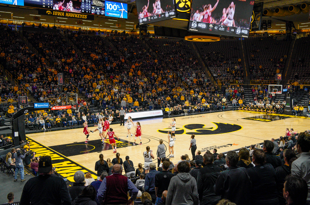 Iowa Hawkeyes fans stand as forward Amanda Ollinger (43) makes a basket while being fouled during the third quarter of their game at Carver-Hawkeye Arena in Iowa City on Sunday, January 12, 2020. (Stephen Mally/hawkeyesports.com)