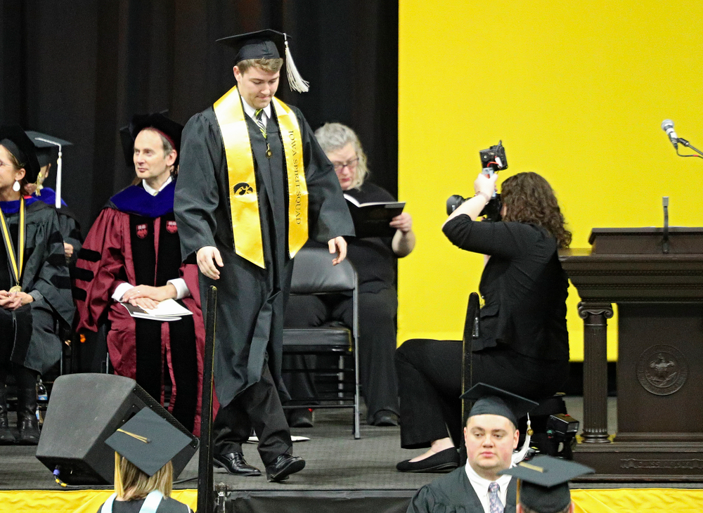 Iowa Spirit Squad's Joseph Bartemes during the College of Liberal Arts and Sciences and University College Fall 2019 Commencement ceremony at Carver-Hawkeye Arena in Iowa City on Saturday, December 21, 2019. (Stephen Mally/hawkeyesports.com)
