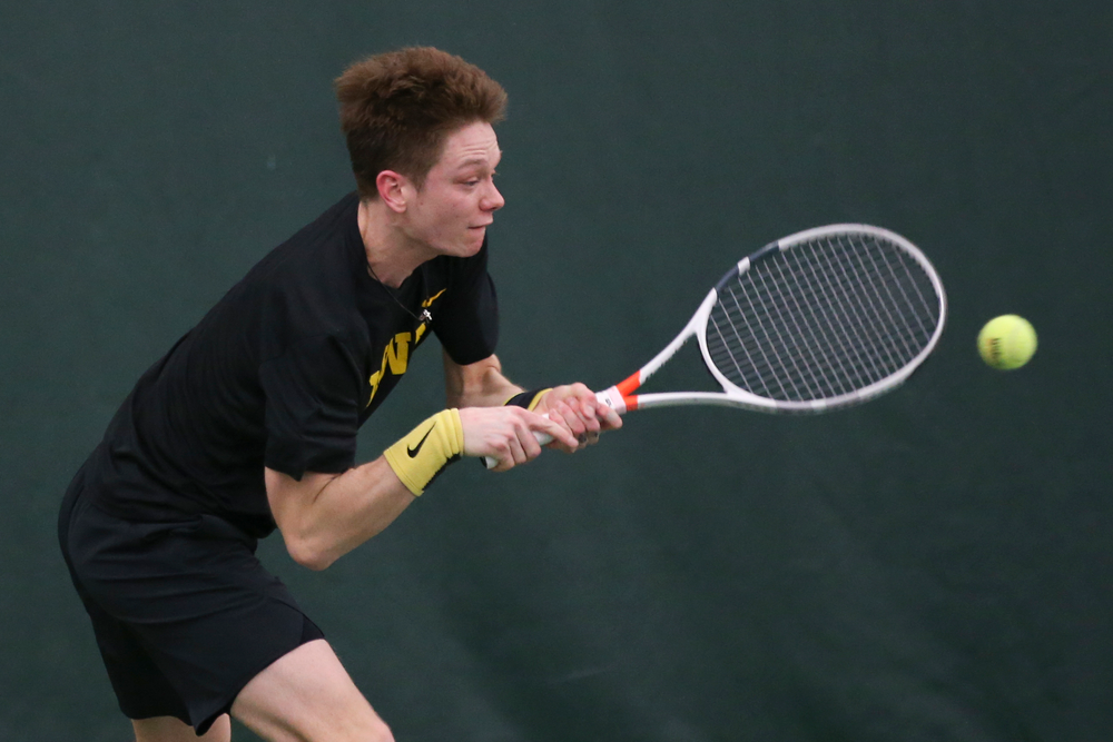 Iowa's Jason Kerst returns a hit during the Iowa men's tennis meet vs VCU  on Saturday, February 29, 2020 at the Hawkeye Tennis and Recreation Complex. (Lily Smith/hawkeyesports.com)