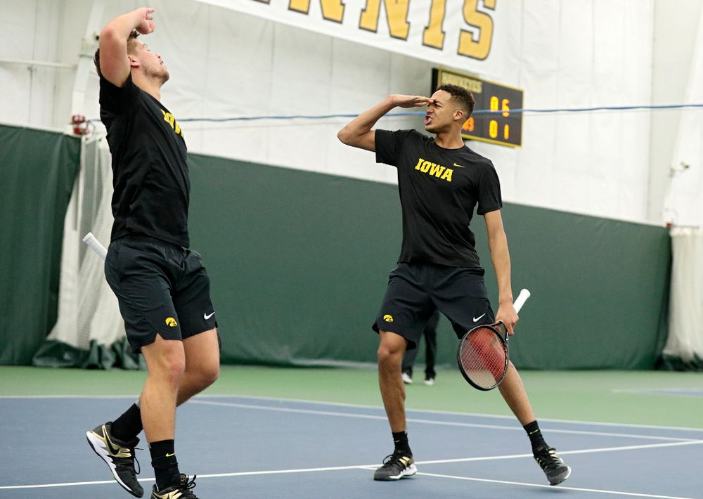 Iowa's Will Davies (from left) and Oliver Okonkwo celebrate a point during their doubles match at the Hawkeye Tennis and Recreation Complex in Iowa City on Friday, February 14, 2020. (Stephen Mally/hawkeyesports.com)