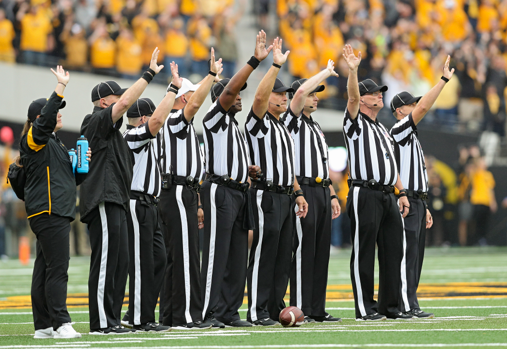Officials wave to the University of Iowa Stead Family Children's Hospital between the first and second quarter of their game at Kinnick Stadium in Iowa City on Saturday, Sep 28, 2019. (Stephen Mally/hawkeyesports.com)