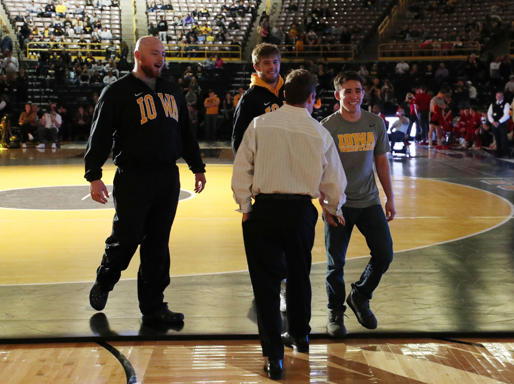 Iowa seniors Sam Stoll, Mitch Bowman, and Perez Perez before their meet against the Indiana Hoosiers Friday, February 15, 2019 at Carver-Hawkeye Arena. (Brian Ray/hawkeyesports.com)