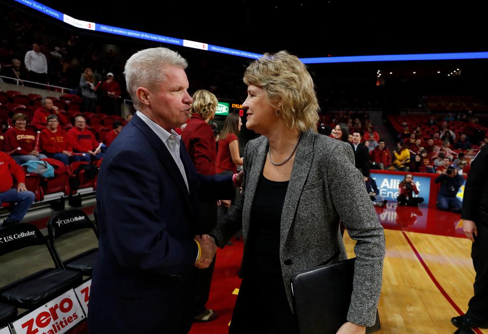 Iowa Hawkeyes head coach Lisa Bluder  and Iowa State Cyclones head coach Bill Fennelly
