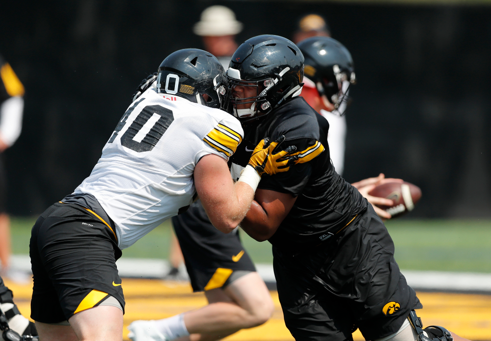 Iowa Hawkeyes offensive lineman Alaric Jackson (77) and defensive end Parker Hesse (40) during fall camp practice No. 9 Friday, August 10, 2018 at the Kenyon Practice Facility. (Brian Ray/hawkeyesports.com)
