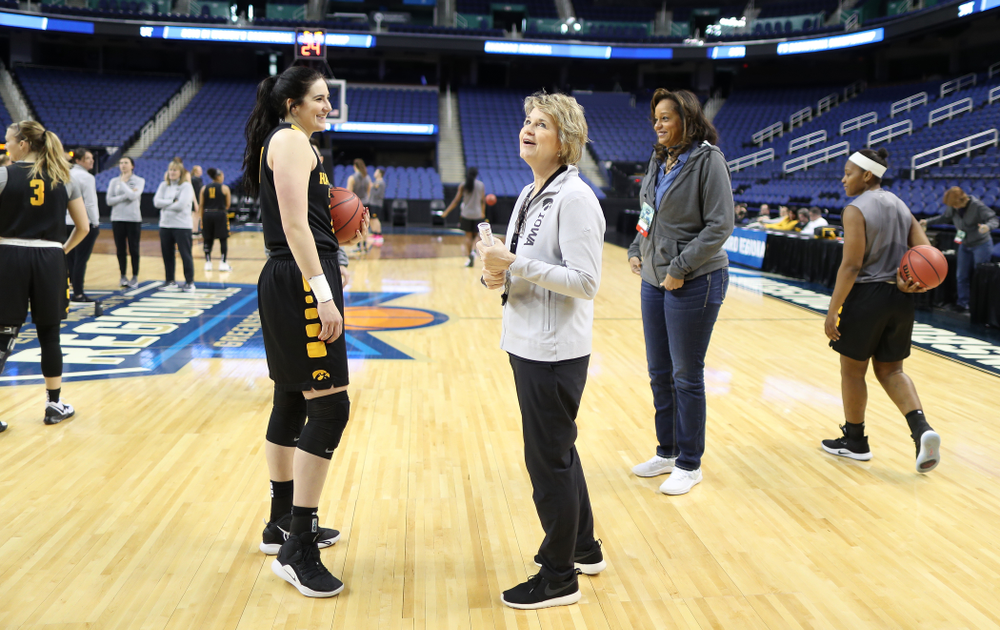 Iowa Hawkeyes forward Megan Gustafson (10) and head coach Lisa Bluder during media and practice as they prepare for their Sweet 16 matchup against NC State Friday, March 29, 2019 at the Greensboro Coliseum in Greensboro, NC.(Brian Ray/hawkeyesports.com)