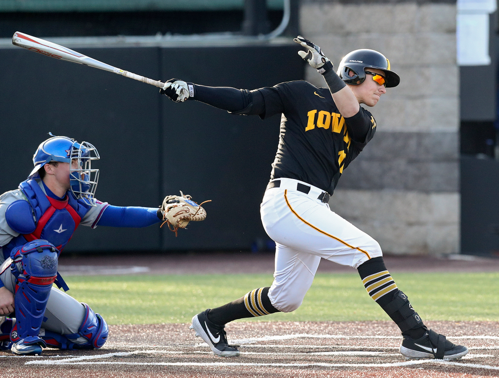 Iowa catcher Tyler Snep (16) drives a pitch for a hit during the fourth inning of their college baseball game at Duane Banks Field in Iowa City on Tuesday, March 10, 2020. (Stephen Mally/hawkeyesports.com)