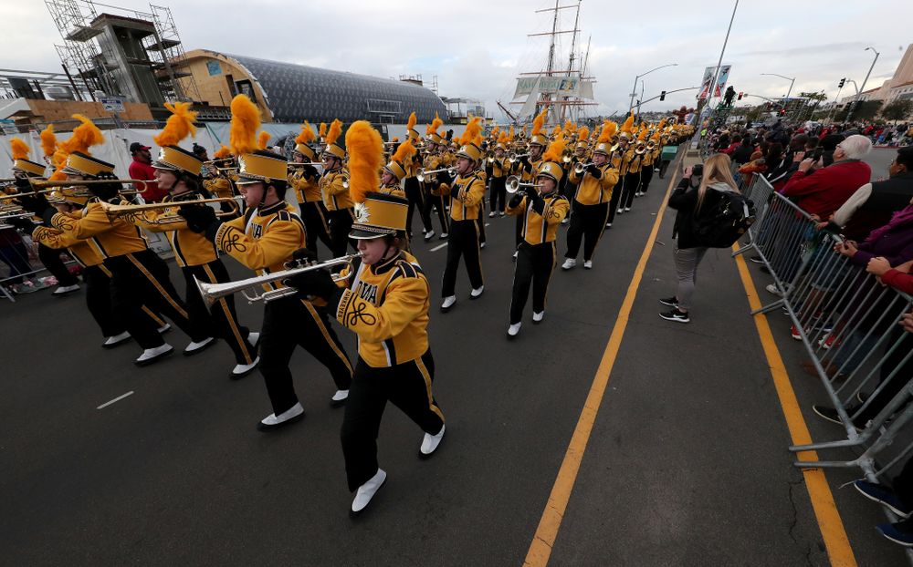 The Hawkeye Marching Band and the Iowa Spirit Squad march in the Holiday Bowl Parade Thursday, December 26, 2019 in San Diego. (Brian Ray/hawkeyesports.com)