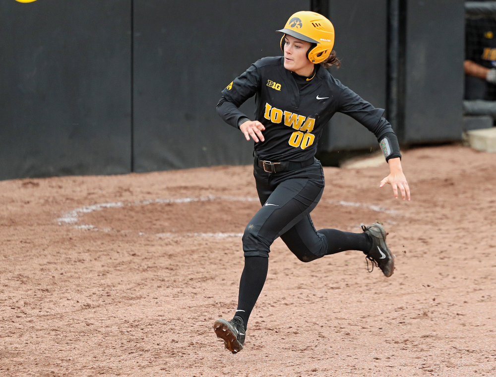 Iowa's Jayci Vos (00) scores a run during the sixth inning of their game against Iowa Softball vs Indian Hills Community College at Pearl Field in Iowa City on Sunday, Oct 6, 2019. (Stephen Mally/hawkeyesports.com)