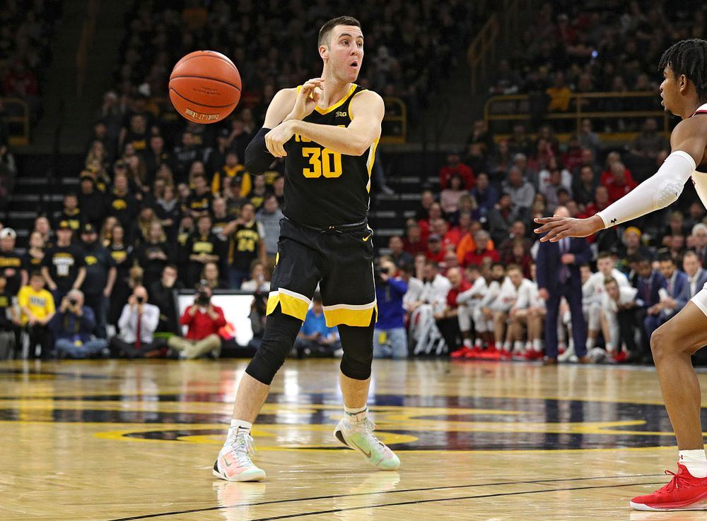 Iowa Hawkeyes guard Connor McCaffery (30) passes the ball during the second half of their game at Carver-Hawkeye Arena in Iowa City on Monday, January 27, 2020. (Stephen Mally/hawkeyesports.com)