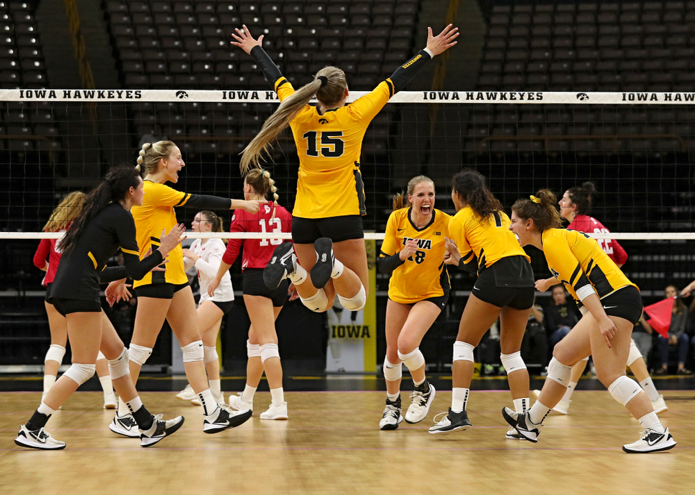 Iowa's Halle Johnston (4), Kyndra Hansen (8), Maddie Slagle (15), Hannah Clayton (18), Brie Orr (7), and Emily Bushman (12) celebrate a score during their match at Carver-Hawkeye Arena in Iowa City on Sunday, Oct 20, 2019. (Stephen Mally/hawkeyesports.com)