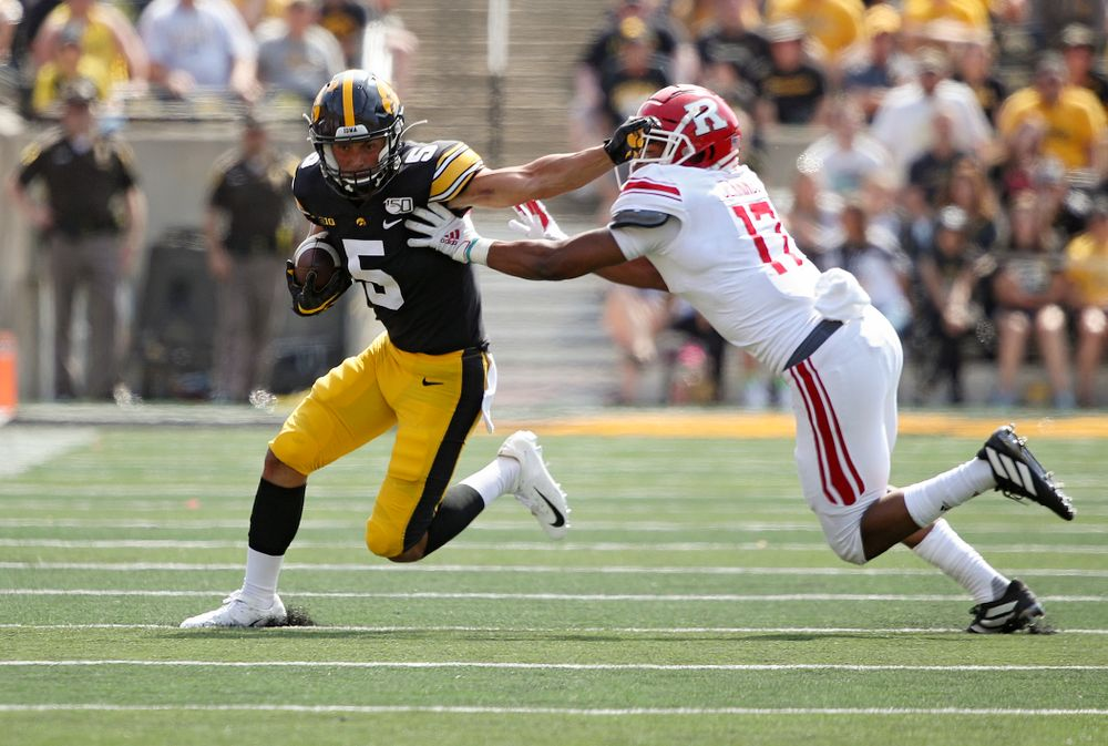 Iowa Hawkeyes wide receiver Oliver Martin (5) stiff-arms a defender after pulling in a pass during the fourth quarter of their Big Ten Conference football game at Kinnick Stadium in Iowa City on Saturday, Sep 7, 2019. (Stephen Mally/hawkeyesports.com)