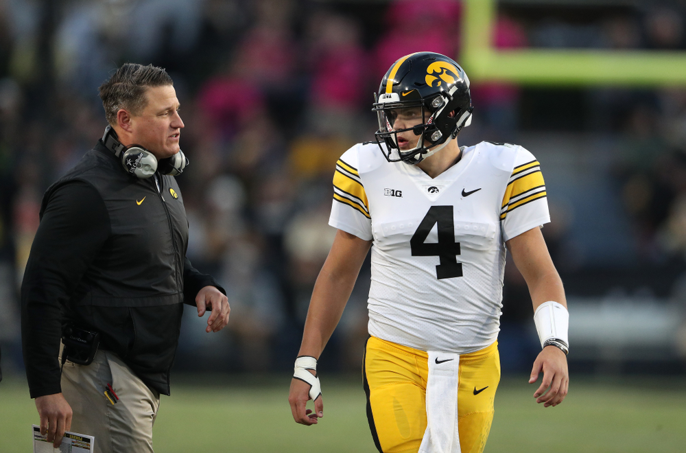 Iowa Hawkeyes offensive coordinator Brian Ferentz and quarterback Nate Stanley (4) against the Purdue Boilermakers Saturday, November 3, 2018 Ross Ade Stadium in West Lafayette, Ind. (Brian Ray/hawkeyesports.com)