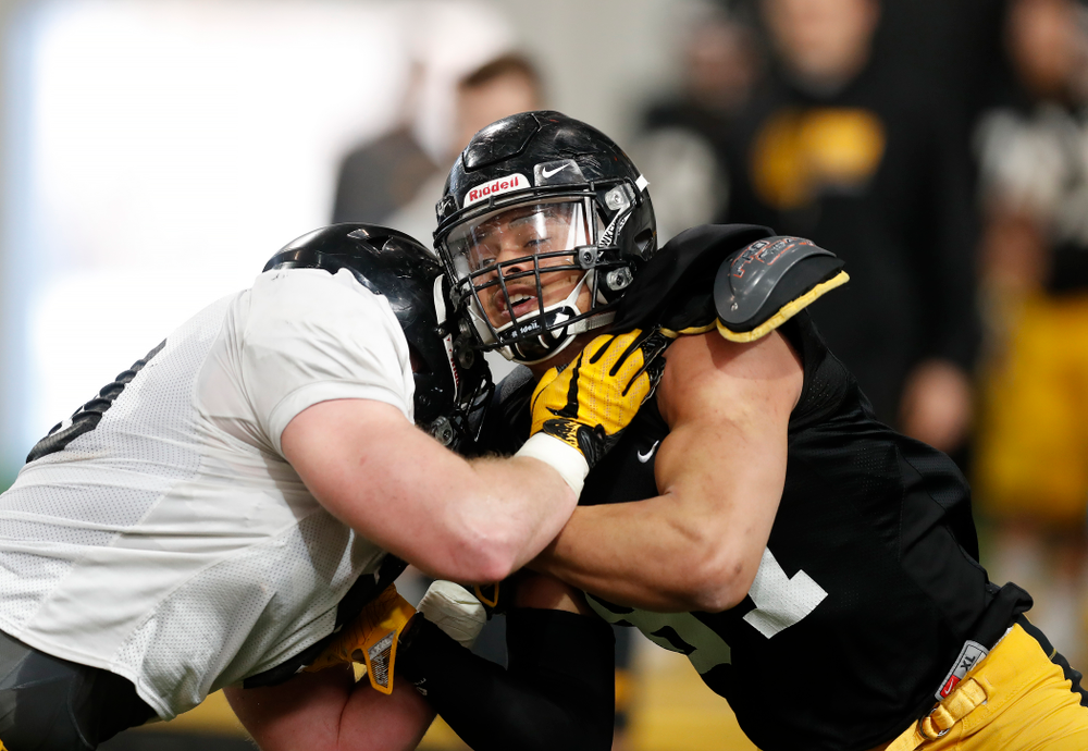 Iowa Hawkeyes tight end Noah Fant (87) and defensive end Parker Hesse (40) during spring practice Wednesday, March 28, 2018 at the Hansen Football Performance Center.  (Brian Ray/hawkeyesports.com)