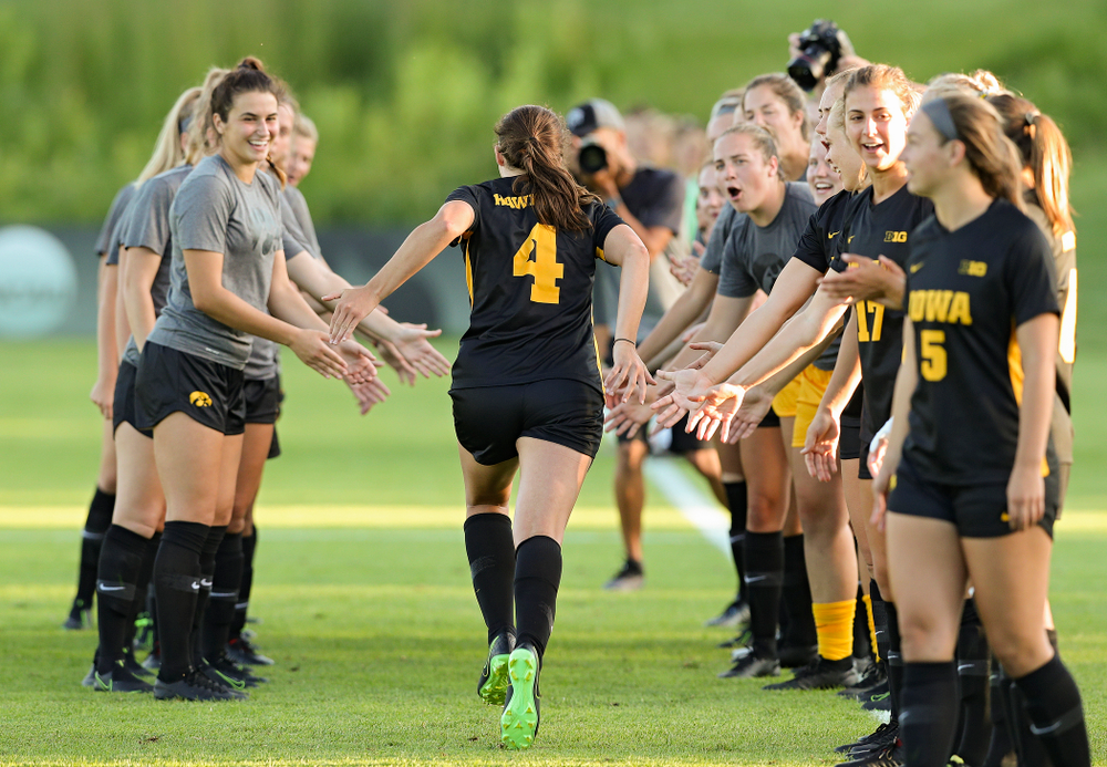 Iowa forward Kaleigh Haus (4) is introduced before the start of their match against Western Michigan at the Iowa Soccer Complex in Iowa City on Thursday, Aug 22, 2019. (Stephen Mally/hawkeyesports.com)