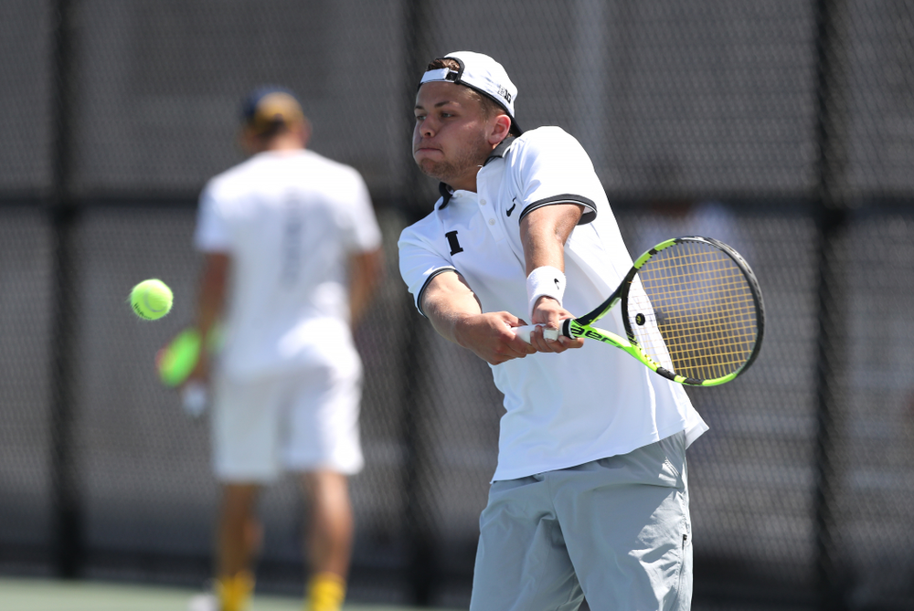 IowaÕs Will Davies against the Michigan Wolverines Sunday, April 21, 2019 at the Hawkeye Tennis and Recreation Complex. (Brian Ray/hawkeyesports.com)