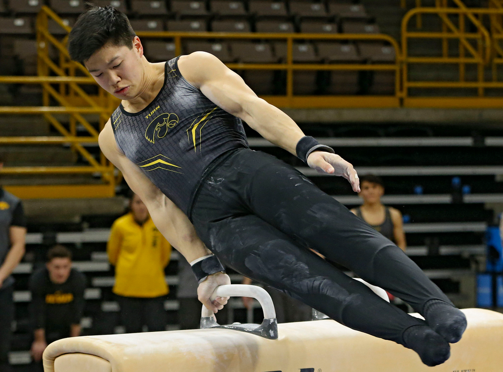 Iowa's Bennet Huang competes in the pommel horse against Ohio State at Caver-Hawkeye Arena in Iowa City on Saturday, Mar. 16, 2019. (Stephen Mally for HawkeyeSports.com)