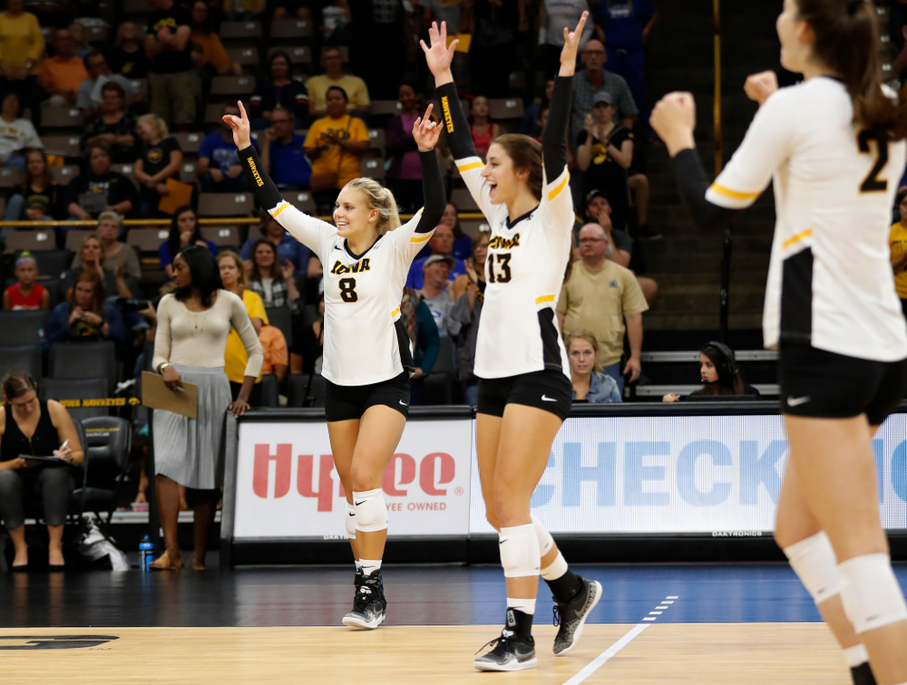 Iowa Hawkeyes right side hitter Reghan Coyle (8) and middle blocker Sarah Wing (13) against Eastern Illinois Sunday, September 9, 2018 at Carver-Hawkeye Arena. (Brian Ray/hawkeyesports.com)