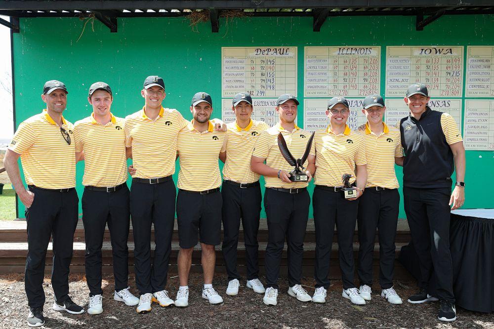 The Iowa Hawkeyes pose with their team trophy after winning the Hawkeye Invitational at Finkbine Golf Course in Iowa City on Sunday, Apr. 21, 2019. (Stephen Mally/hawkeyesports.com)