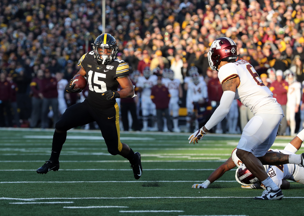 Iowa Hawkeyes running back Tyler Goodson (15) scores against the Minnesota Golden Gophers Saturday, November 16, 2019 at Kinnick Stadium. (Brian Ray/hawkeyesports.com)