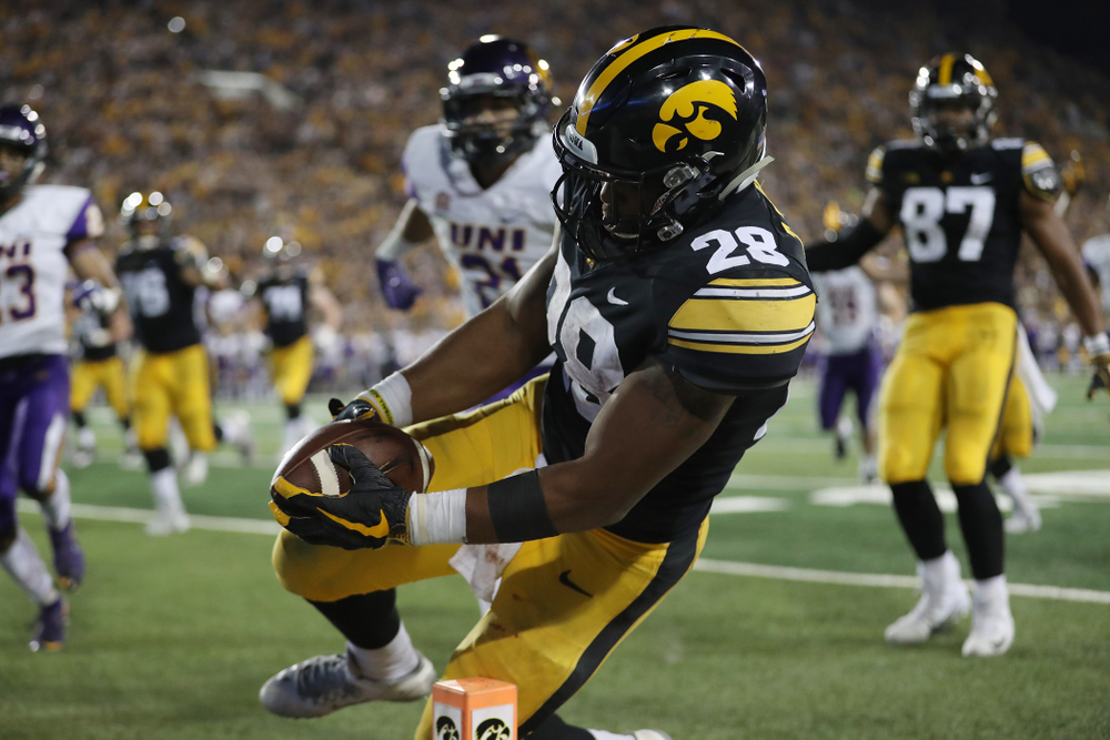 Iowa Hawkeyes running back Toren Young (28) scores against the Northern Iowa Panthers Saturday, September 15, 2018 at Kinnick Stadium. (Max Allen/hawkeyesports.com)