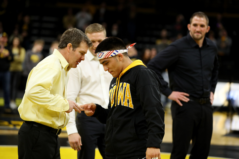 Iowa Hawkeyes head coach Tom Brands shakes hands with senior Pat Lugo during senior day activities Sunday, February 23, 2020 at Carver-Hawkeye Arena. (Brian Ray/hawkeyesports.com)