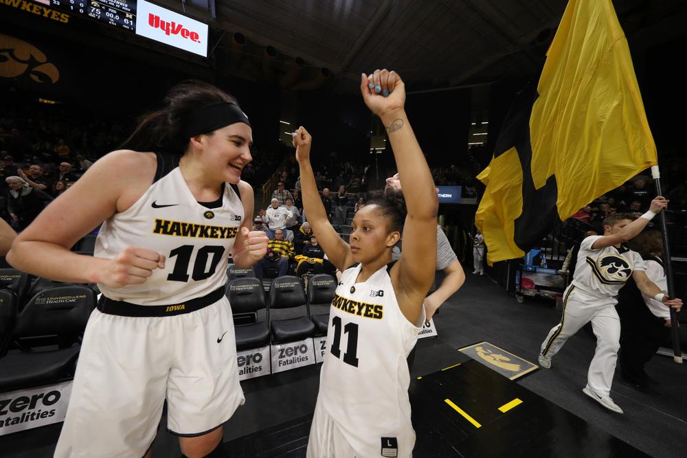 Iowa Hawkeyes forward Megan Gustafson (10) and guard Tania Davis (11) against the Michigan Wolverines Thursday, January 17, 2019 at Carver-Hawkeye Arena. (Brian Ray/hawkeyesports.com)