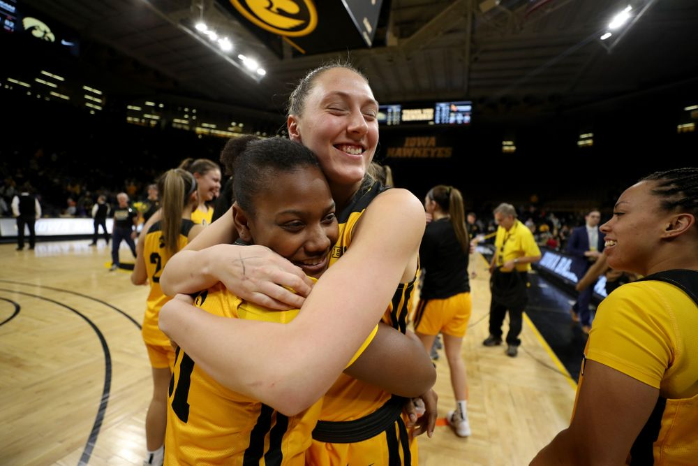 Iowa Hawkeyes forward Amanda Ollinger (43) and guard Zion Sanders (21) during senior day activities following their win over the Minnesota Golden Gophers Thursday, February 27, 2020 at Carver-Hawkeye Arena. (Brian Ray/hawkeyesports.com)