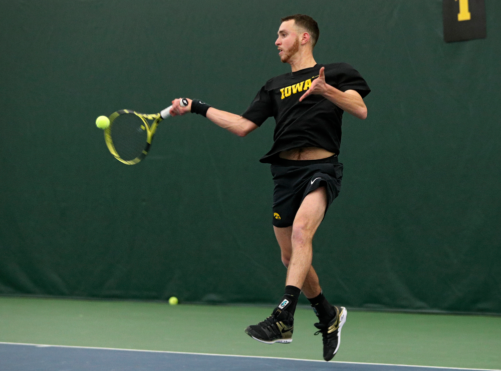 Iowa's Kareem Allaf returns a shot during his singles match at the Hawkeye Tennis and Recreation Complex in Iowa City on Friday, March 6, 2020. (Stephen Mally/hawkeyesports.com)