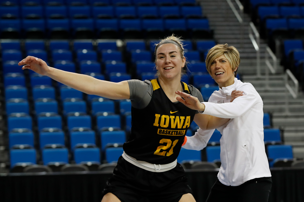 Iowa Hawkeyes forward Hannah Stewart (21) works against associate head coach Jan Jensen during practice Friday, March 16, 2018 at Pauley Pavilion on the campus of UCLA. (Brian Ray/hawkeyesports.com)