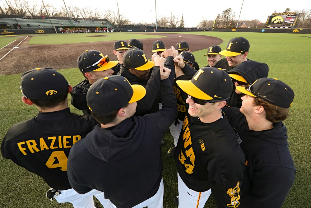 The Hawkeyes huddle before their game at Duane Banks Field in Iowa City on Tuesday, March 3, 2020. (Stephen Mally/hawkeyesports.com)