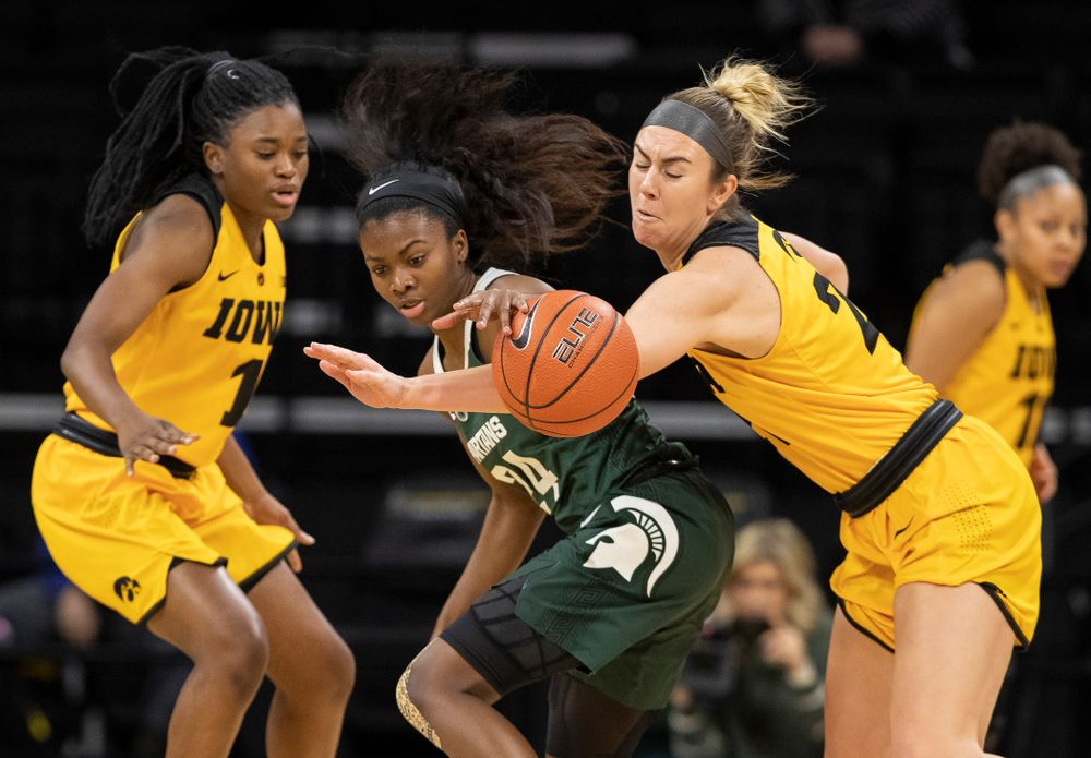 Iowa Hawkeyes forward Hannah Stewart (21) steals the ball against the Michigan State Spartans Thursday, February 7, 2019 at Carver-Hawkeye Arena. (Brian Ray/hawkeyesports.com)