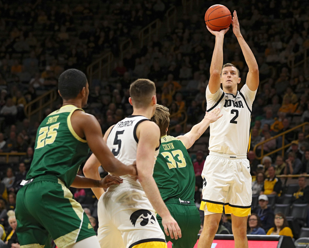 Iowa Hawkeyes forward Jack Nunge (2) puts up a shot during the first half of their game at Carver-Hawkeye Arena in Iowa City on Sunday, Nov 24, 2019. (Stephen Mally/hawkeyesports.com)