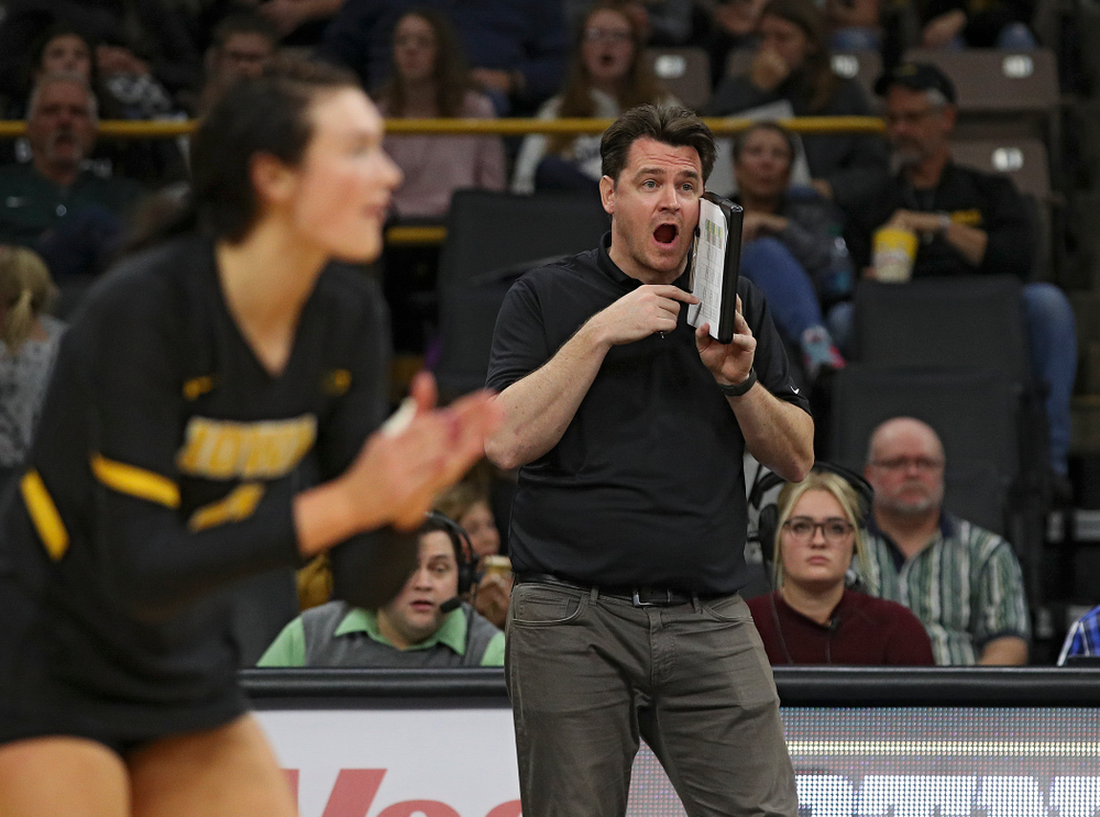 Iowa assistant coach Bobby Hughes shouts to his team during the second set of their volleyball match at Carver-Hawkeye Arena in Iowa City on Sunday, Oct 13, 2019. (Stephen Mally/hawkeyesports.com)