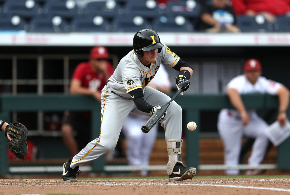 Iowa Hawkeyes infielder Brendan Sher (2) puts down a sacrifice bunt against the Indiana Hoosiers in the first round of the Big Ten Baseball Tournament Wednesday, May 22, 2019 at TD Ameritrade Park in Omaha, Neb. (Brian Ray/hawkeyesports.com)