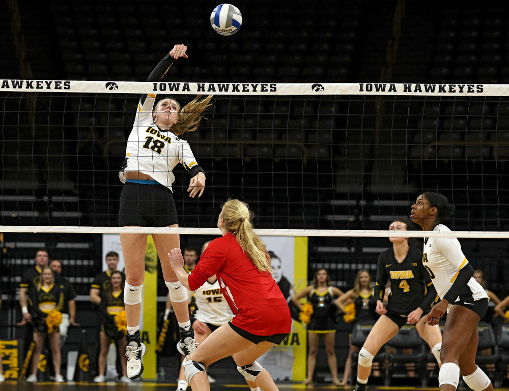 Iowa's Hannah Clayton (18) sends the ball over the net during the first set of their match at Carver-Hawkeye Arena in Iowa City on Saturday, Nov 30, 2019. (Stephen Mally/hawkeyesports.com)